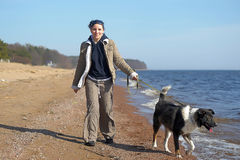 Young woman with a dog walks Royalty Free Stock Images