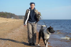 Young woman with a dog walks Stock Photos