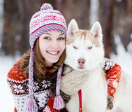 Young woman with dog winter outdoors fun Royalty Free Stock Photos