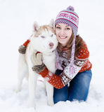 Young woman with dog winter outdoors fun Royalty Free Stock Image