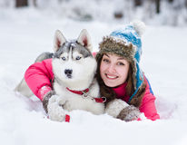 Young woman with dog winter outdoors fun Royalty Free Stock Photo