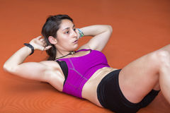 Young woman doing abdominal Stock Photo