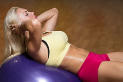 Young Woman Doing Abs Workout Stock Image