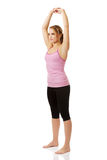 Young woman doing aerobic exercise. Stock Images