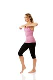 Young woman doing aerobic exercise. Royalty Free Stock Photography