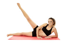 Young woman doing aerobics Stock Images