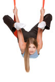 Young woman doing anti-gravity aerial yoga Stock Photos