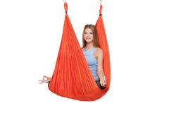 Young woman doing anti-gravity aerial yoga Stock Images