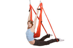 Young woman doing anti-gravity aerial yoga in  red Stock Photos