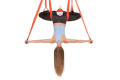 Young woman doing anti-gravity aerial yoga in Royalty Free Stock Images