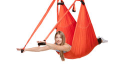 Young woman doing anti-gravity aerial yoga in Stock Image