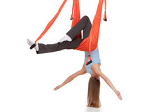 Young woman doing anti-gravity aerial yoga in Stock Photo