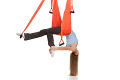 Young woman doing anti-gravity aerial yoga in Stock Images