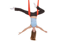 Young woman doing anti-gravity aerial yoga in Royalty Free Stock Photo