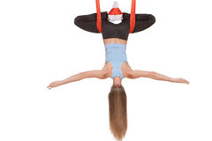 Young woman doing anti-gravity aerial yoga in Royalty Free Stock Photography