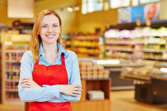 Young woman doing apprenticeship in supermarket. Young happy smiiling woman doing apprenticeship in a supermarket royalty free stock images