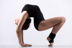 Young woman doing backbending exercise Royalty Free Stock Image