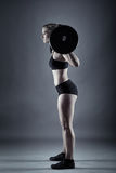 Young woman doing barbell squats Royalty Free Stock Photos