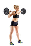 Woman doing barbell squats Royalty Free Stock Photos