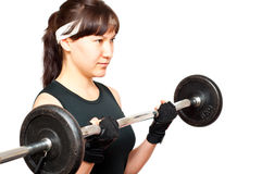 Young woman doing a bicep curl Stock Photography