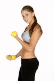Young Woman Doing Bicep Curls Royalty Free Stock Images