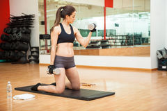 Young woman doing bicep curls at the gym Stock Photos