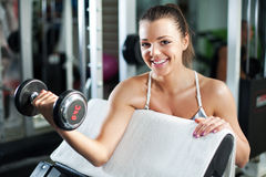Young woman doing Biceps exercise Royalty Free Stock Photos