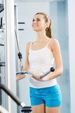 Young woman doing body-building in the Gym. Live a healthy life Royalty Free Stock Photos