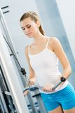 Young woman doing body-building in the Gym Stock Photo