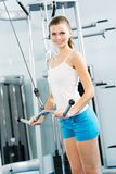 Young woman doing body-building in the Gym. Live a healthy life Stock Photography