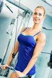 Young woman doing body-building in the Gym Royalty Free Stock Photo