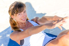 Young woman doing bodyflex, fitness, sport workout out Royalty Free Stock Image