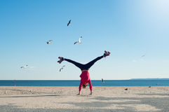 Young woman doing cartwheel Royalty Free Stock Photography