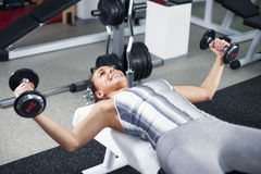 Young woman doing chest exercise Stock Photography