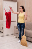 The young woman doing cleaning at home Stock Photography