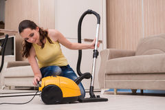 The young woman doing cleaning at home Stock Images