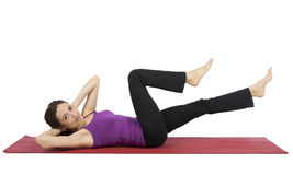 Young woman doing crunch during workout stock image
