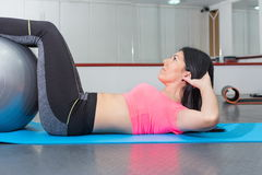 Young woman doing crunches  the gym Stock Image
