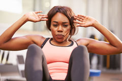 Young woman doing crunches in a gym, close up Royalty Free Stock Image