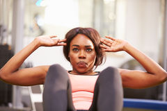 Young woman doing crunches in a gym, close up Royalty Free Stock Photography