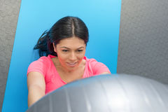 Young woman doing crunches  the gym Stock Images