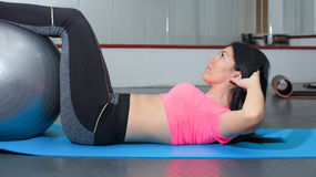 Young woman doing crunches the gym stock photos