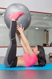 Young woman doing crunches  with pilates ball Stock Images