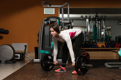 Young Woman Doing Deadlift For Back Royalty Free Stock Image