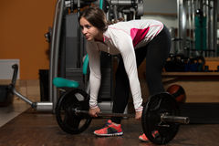 Young Woman Doing Deadlift For Back Royalty Free Stock Photo