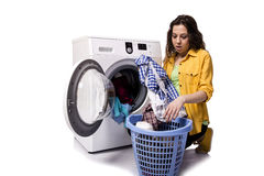 The young woman doing dirty laundry isolated on white Stock Images