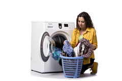 The young woman doing dirty laundry  on white Stock Photography