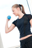 Young woman doing dumbbell exercises Royalty Free Stock Images