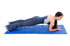 Young woman doing Elbow Plank Workout. Young woman shows Elbow Plank Workout, isolated on white, side view stock photography