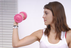 Young woman doing excercise Stock Photo